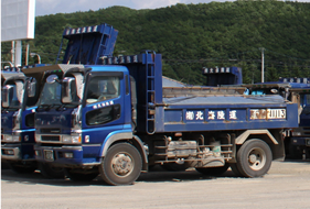 Dump truck transport of materials and wastes